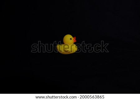 defocused yellow duck toys in the picture