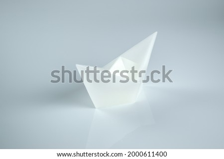 A white ship on a white background. A picture of minimalism