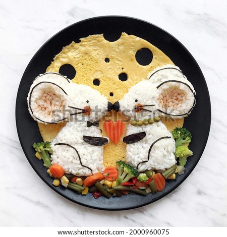 Healthy food for kids. Food art on the plate made out of rise, nori seaweed and vegetables. Two little mice, lovely, moon. Cute illustration. Creative picture