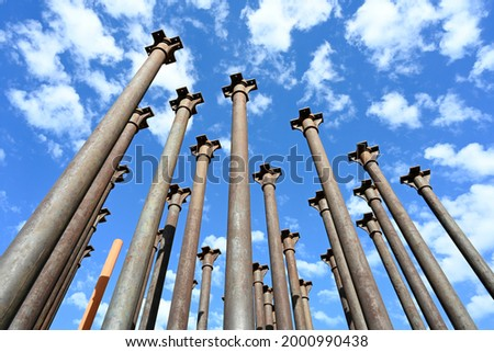 monument made from the columns recovered from the demolition of the old factory   Royalty-Free Stock Photo #2000990438