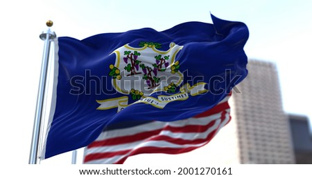 The flags of the Connecticut state and United States of America waving in the wind. Democracy and independence. American state. Royalty-Free Stock Photo #2001270161