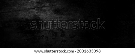 Scary dark wall, low light black concrete cement texture for background