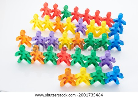 Rainbow, colourfull people concept. High resolution photo for graphic design. Different race, different skin colour concept, plastic people statuettes holdings hands.