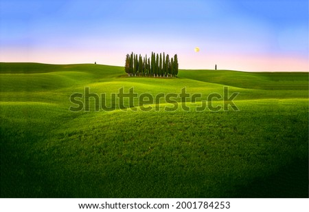 Green hills in the early morning.Summer green hills landscape. Summer green hills at dawn Royalty-Free Stock Photo #2001784253