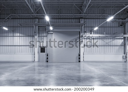 Roller door or roller shutter using for factory, warehouse or hangar. Industrial building interior consist of polished concrete floor and closed door for product display or industry background. #200200349