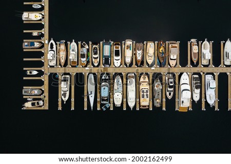 Boats in a Marina looking straight down from above.