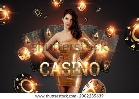 Beautiful girl on the background of the golden casino atrebutics. Winning, casino advertising template, gambling, vegas games, betting Royalty-Free Stock Photo #2002235639