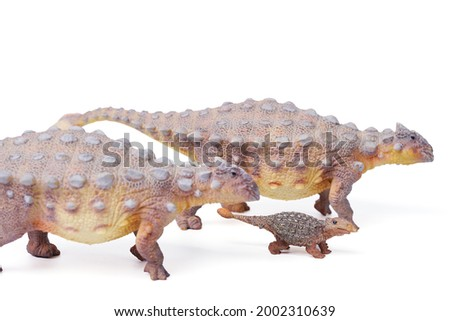 Ankylosaurus is a herbivore genus of armored dinosaur with baby, the dinosaur from the very end of the Cretaceous period. isolated on white background. closeup dinosaur and monster model. Royalty-Free Stock Photo #2002310639