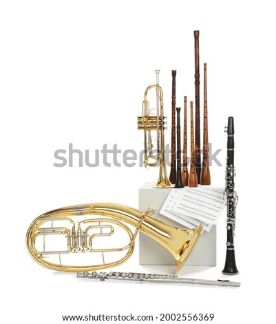 Set of wind musical instruments on white background Royalty-Free Stock Photo #2002556369
