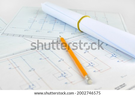 Printed electrical diagram, blurred background. Workplace of an electrician designer. Engineer's drawing on a white background Royalty-Free Stock Photo #2002746575