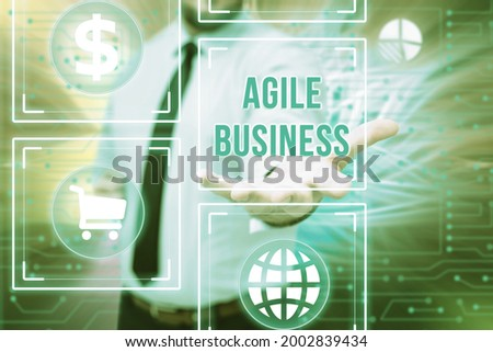 Sign displaying Agile Business. Word Written on capability of adjusting quickly to the market s is trend Gentelman Uniform Standing Holding New Futuristic Technologies.