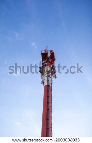 Technology on the top of the telecommunication GSM 5G,4G,3G tower.Cellular phone antennas on a building roof.Telecommunication mast television antennas.Receiving and transmitting stations Royalty-Free Stock Photo #2003006033