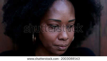 Preoccupied African woman. Pensive stressed black person feeling anxiety.jpeg
