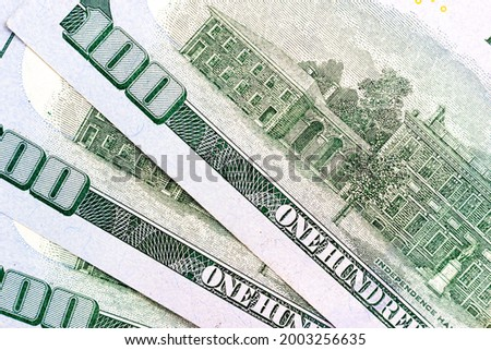 Reverse side of a hundred dollar bill. Several hundred dollar bills close up. Palace of Independence on a hundred dollar bill. 100 dollars. Royalty-Free Stock Photo #2003256635