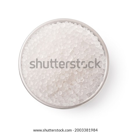 Top view of glass bowl of silica gel granules isolated on white Royalty-Free Stock Photo #2003381984