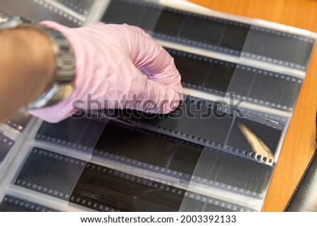 Storage of photographic films in special albums and containers.