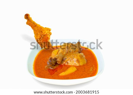 Yellow Curry Chicken (Massaman Curry Chicken) isolated on white background