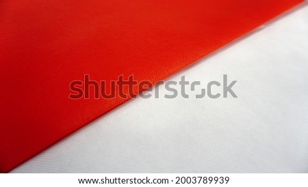 Photo of two stacked fabrics forming a unique pattern of the Indonesian flag