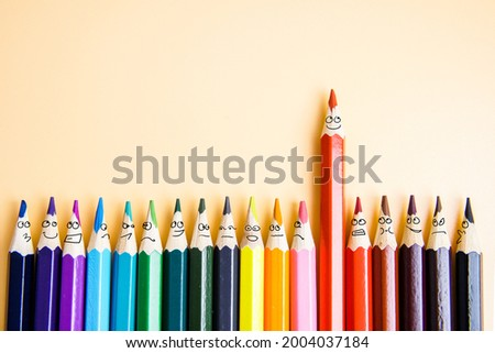 Colorful pencils as the emotions of the faces of isolated people. The concept of success.