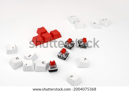 Mechanical keyboard switch on a white background. WASD keyboard buttons. Concept of computer games, gaming and esports. Royalty-Free Stock Photo #2004075368
