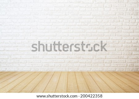 empty room with white brick wall and wooden floor #200422358
