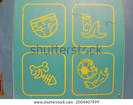 Images of different types of garbage on a mixed waste container, organic waste, symbols of waste types