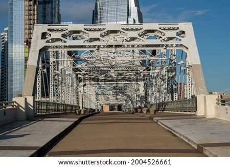 John Seigenthaler pedestrian bridge or Shelby street crossing leaving downtown Nashville Tennessee Royalty-Free Stock Photo #2004526661