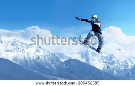 Snowboarder making jump high in clear sky #200456585