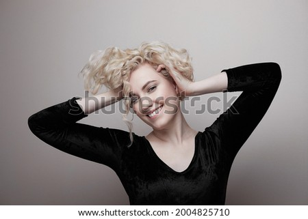 Headshot of gorgeous attractive young lady with curly hair smiling. Marilyn Monroe.