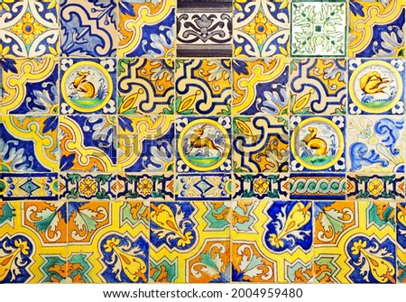 Abstract composition with reused Triana tiles. Current modern trend of sustainable and colorful decorative background. Triana neighborhood Seville Spain
