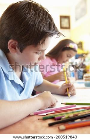 Pre teen children in art class #200519843