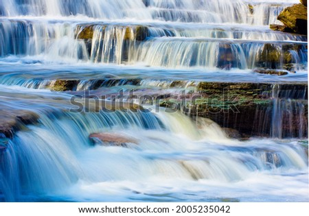 """Cascades at Albion. Albion Falls is a 19-meter-high cascade waterfall. Cascade waterfalls flow over a series of steps, causing water to """"cascade"""" Royalty-Free Stock Photo #2005235042"""