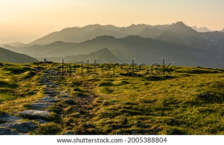A beautiful summer morning in the mountains. Morning mists give a fairy-tale scenery between the ridges. Royalty-Free Stock Photo #2005388804