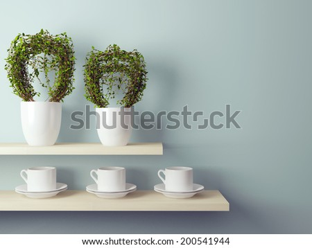 White cups and flowerpot on the shelf in front of gray wall.  #200541944