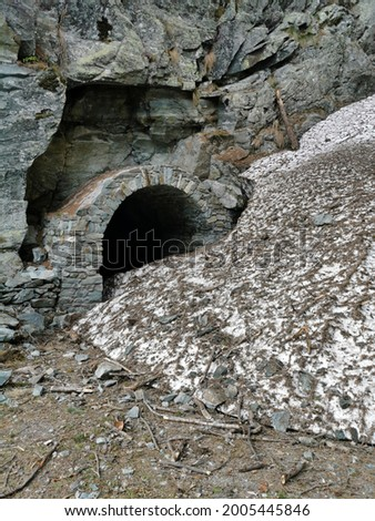 One of the 14 galleries on the trekking path between Brusson and Col De Joux in Val D'Ayas, Aosta, Italy. Here a snow slide obstructed the way in early june Royalty-Free Stock Photo #2005445846