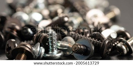 Screws and bolts fasteners industrial black background Royalty-Free Stock Photo #2005613729