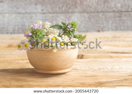 happy birthday greeting card. wildflowers in clay vase. valentine's day
