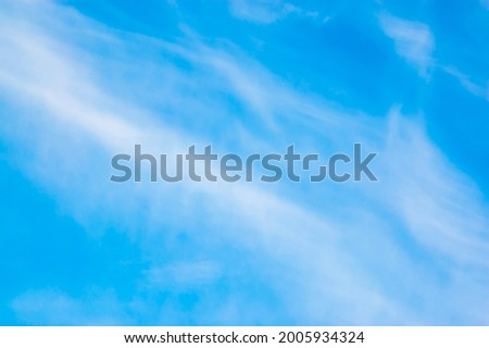 Blue sky background with white stratus clouds. Picture for weather forecast, desktop.