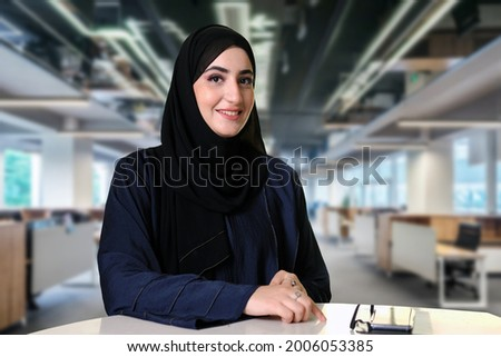 Authentic Arab at office wearing cultural Abaya an Hijab Middle East women's clothing Royalty-Free Stock Photo #2006053385