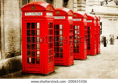 vintage style picture of British phone boxes in London