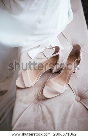 Beautiful wedding shoes. Gentle wedding picture. Pink wedding shoes with bride in the background. Modern wedding concept.
