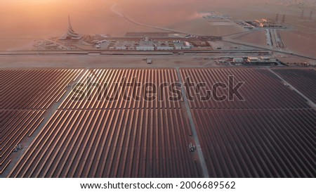 AERIAL. Top view of huge power plant and solar panel at UAE. Royalty-Free Stock Photo #2006689562
