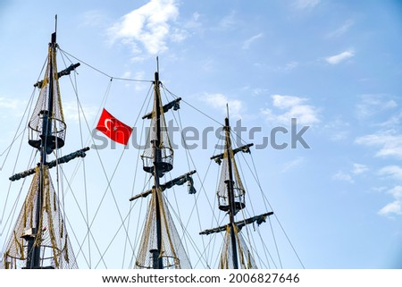 The masts of the ship with the Turkish flag on the background of the blue sky. The concept of travel and freedom Royalty-Free Stock Photo #2006827646