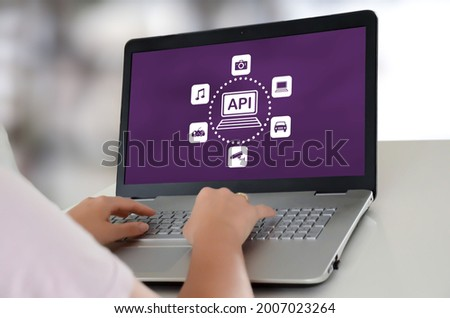 Woman using a laptop with api concept on the screen