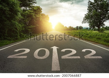 New year 2022 or straightforward concept. Text 2022 written on the road in the middle of asphalt road at sunset.Concept of planning and challenge, business strategy, opportunity ,hope, new life change Royalty-Free Stock Photo #2007066887
