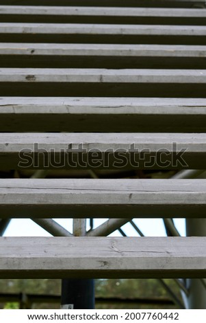 Old gray wooden stairs. Diagonal lines. Abstraction. From big to small stripes. High quality photo Royalty-Free Stock Photo #2007760442