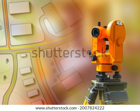 Optical theodelite on a tapographic background. Concept - topographic equipment. Theodelite is mounted on a tripod. Surveyor's device. Equipment for geodesy. Sale of devices for surveyors Royalty-Free Stock Photo #2007824222