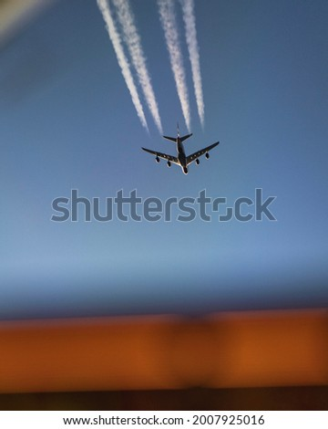 A photo of an airplane which was taken from the airplane below.