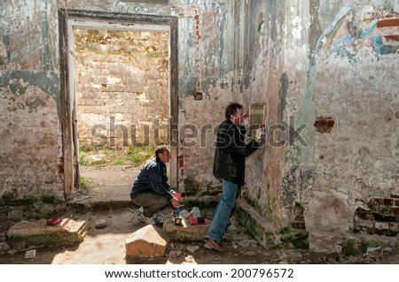 STARITSA, TVERSKAYA REGION/RUSSIA - MAY 03: Two geophysicists make experiment for Space Memory investigation in ancient stone church with fresco on walls on May 03, 2014 in Staritsa.	 #200796572