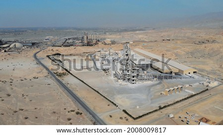 AERIAL. Top view of industry manufactory in UAE. Huge cement factory in desert. Royalty-Free Stock Photo #2008009817